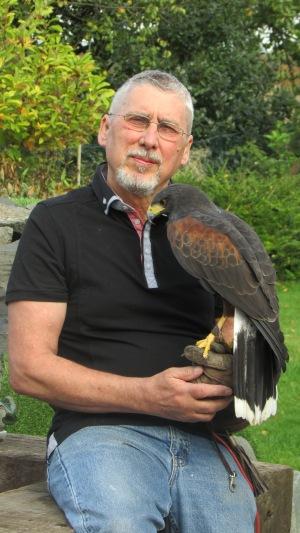 Trevor pic with a falcon portrait.JPG